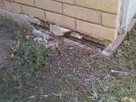 rebar exposed on foundation-spalling.jpg