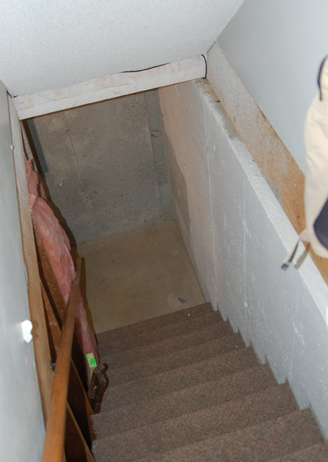 Basement Concrete Wall Framing Against Stairs Remodeling