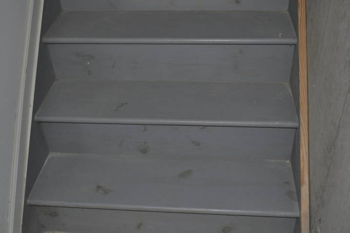 how to finish basement stairwell concrete wall-stairs_bottom_closeup.jpg