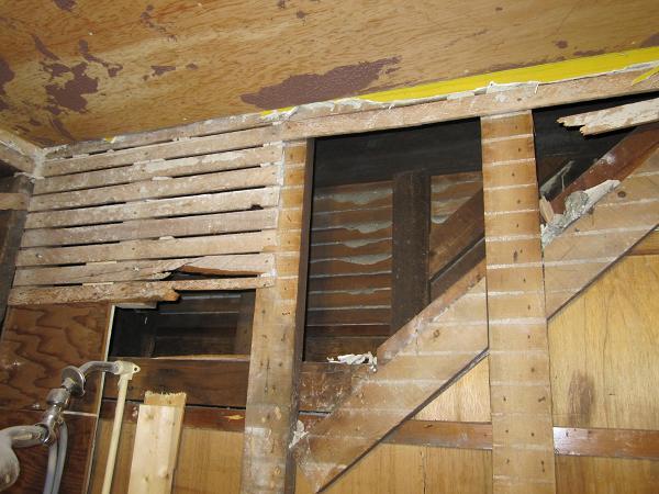 Insulating under stairs-stairwell-gap.jpg