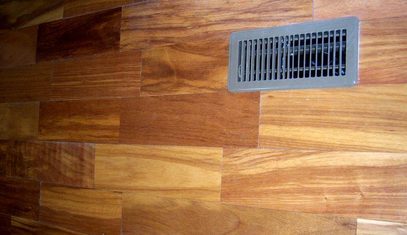 Oak trimming her new foyer.-teak-floor.jpg