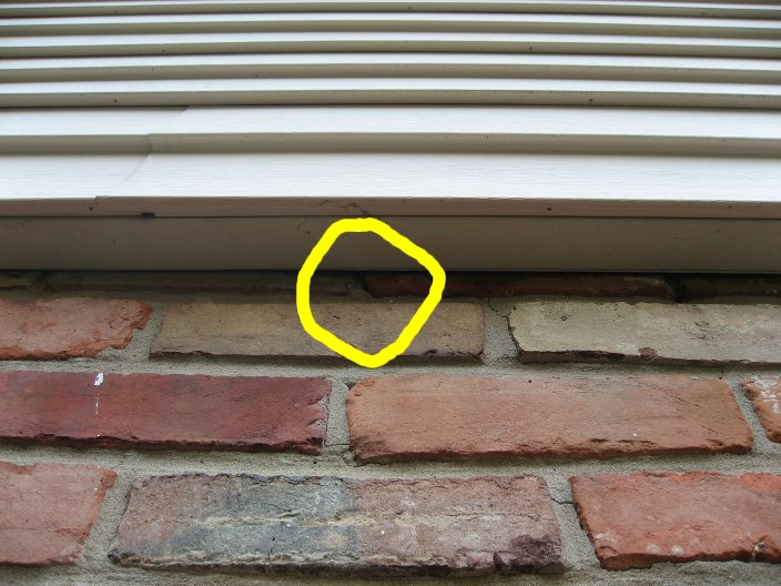 Is it ok to caulk where siding overlaps brick?-test1.jpg