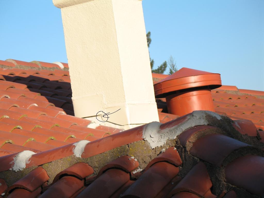 Stucco and Flashing at Base of Chimney Need Repair-tile-chimney.jpg