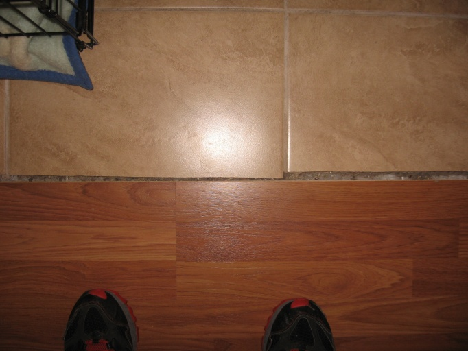 At Baseboard For Flooring Transitions At Tile And Carpet Transition