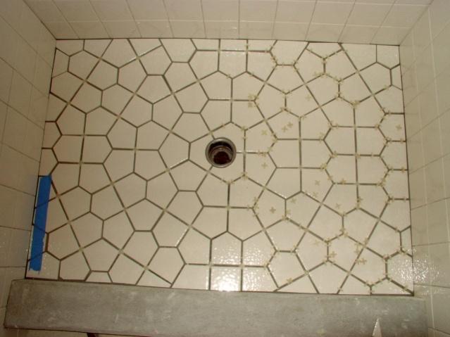Tiling A Shower Floor 1175 a sheet carrara venato 3x3 hexagon marble mosaic tile honed part way through an installation shower bathroomshower floorshower Shower Pan Slope Tile Shower Floor Layoutjpg