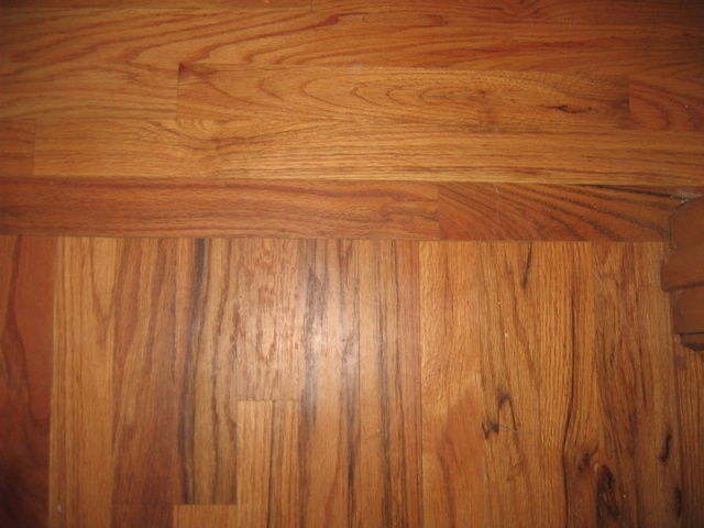 Wood Laminate Hallway Transition At Junction Flooring