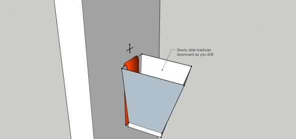 Cutting a hole for an electrical box-trash-can-drill-clean.jpg