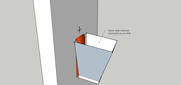 Cutting a hole for an electrical box-trash-can-drill-clean.jpg
