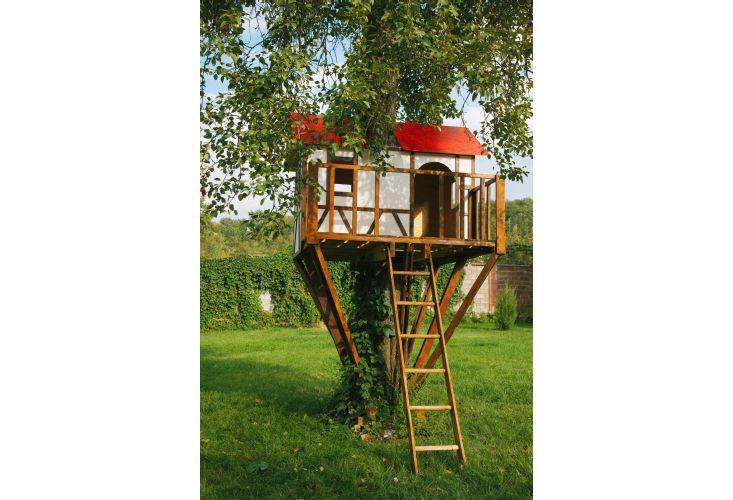 Cute small tree house for kids on backyard