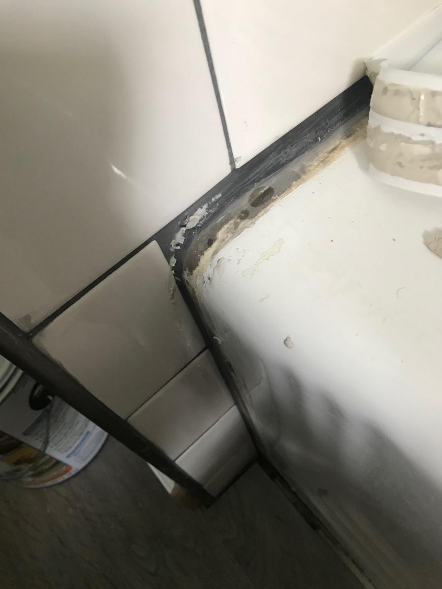 Repairing a botched tile job-tub-1.jpg