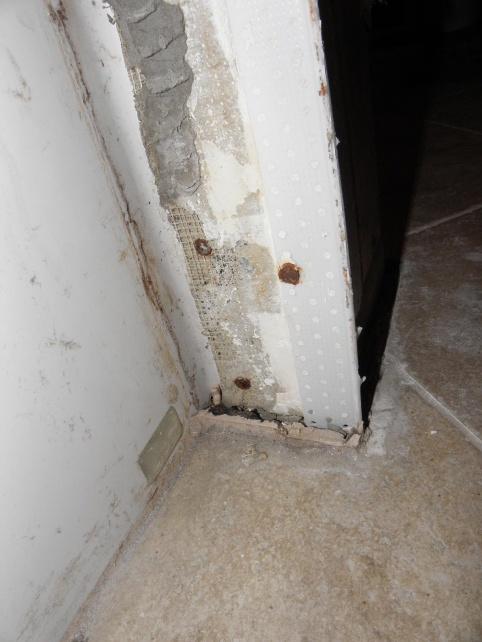 Water issue in bathroom at base of the tub and shower plumbing wall-tub-flange.jpg
