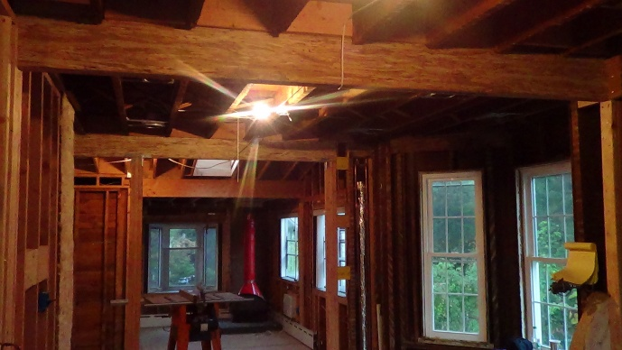 NJ Colonial - Family Remodel-tv-room-beams-replaced-into-kitchen-view.jpg