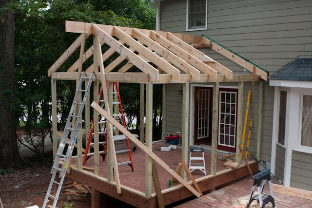 Screened porch project-two-more-rafters-go.jpg