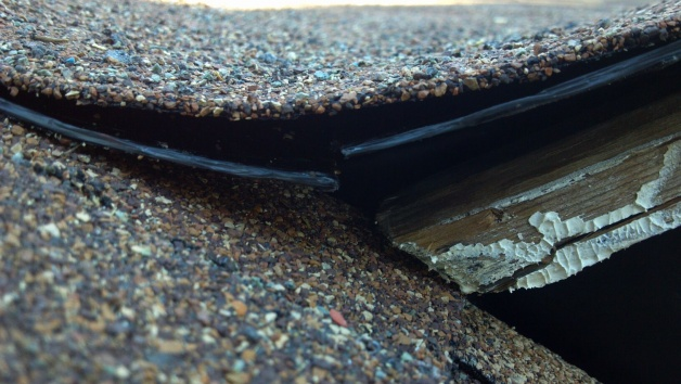 self adhered modified bitumen install advice-base & cap lifted at roof edge-unattached-membranes.jpg