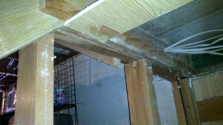 Are these studs likely loadbearing? Can I move one?-under-stairs-view.jpg