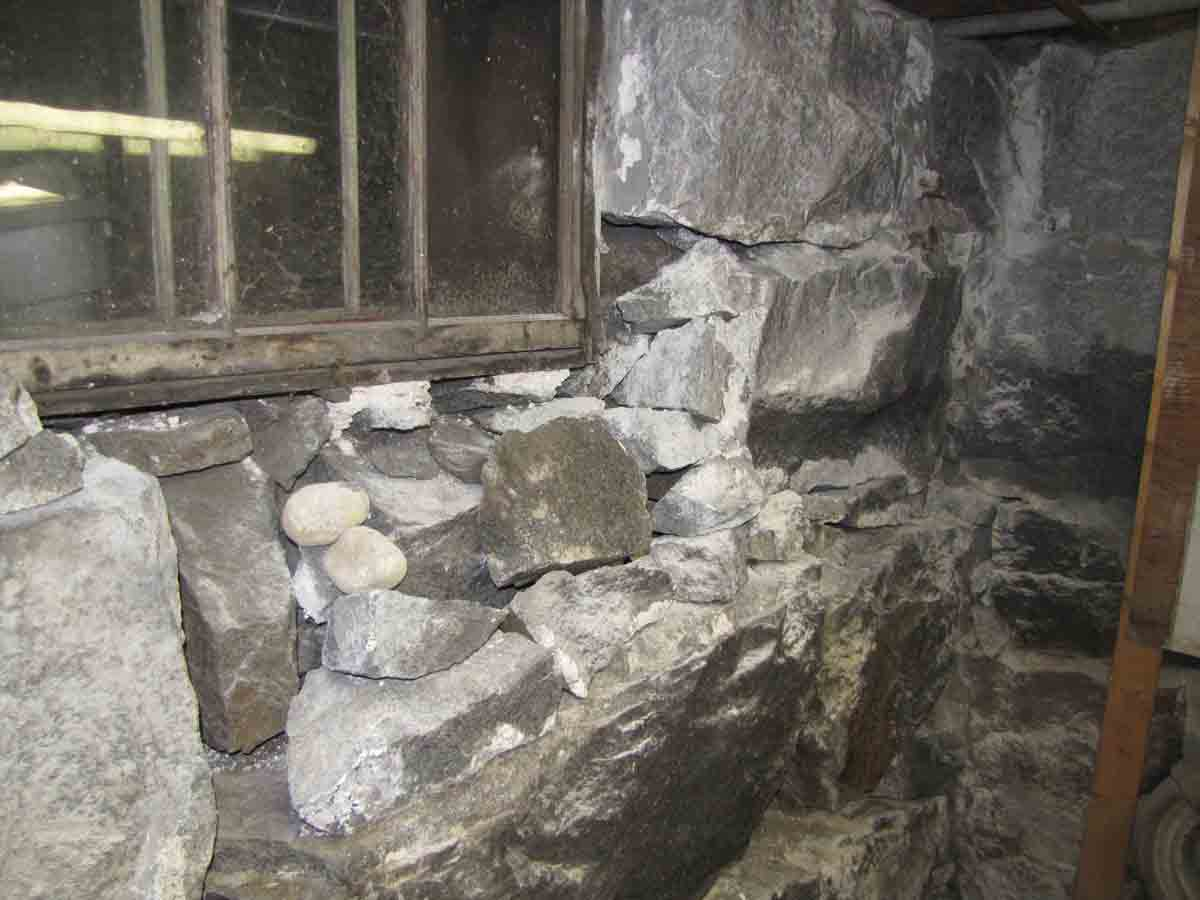 expanding foam for gaps in masonry foundation-under_window.jpg