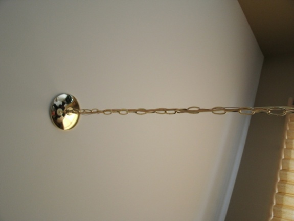 hanging light fixture; wire twists as chain tightened-untitled-1.jpg