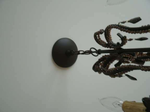 hanging light fixture; wire twists as chain tightened-untitled-3.jpg