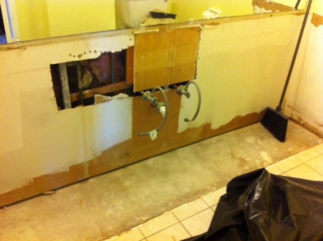 Huge hole behind sink how to cover?-vanity-removal.jpg