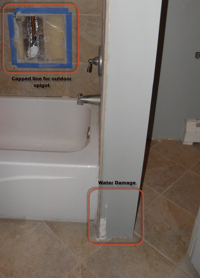 Water issue in bathroom at base of the tub and shower plumbing wall-view-damage-capped-spigot.jpg
