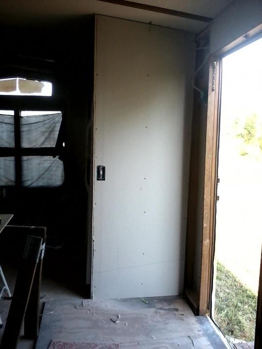 Complete Mobile Home Remodel-wall-beside-front-door.jpg