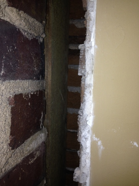 Fixing a gap between plaster wall and brick wall-wall.jpg