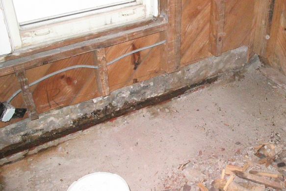 Fix my mess: Porch seeping water to interior under brick wall-wall.jpg