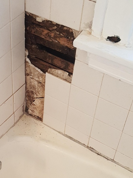 Bathroom Wall Hole....How bad is this(moved)-wall-zoomed.jpg