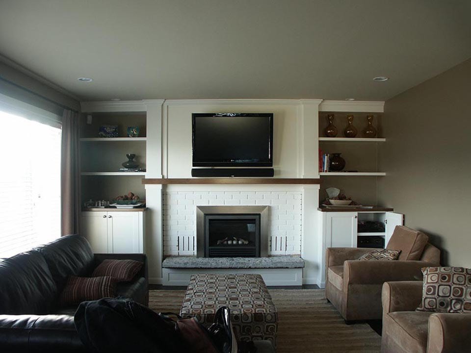 White Fireplace And Dark Cabinets Match Interior