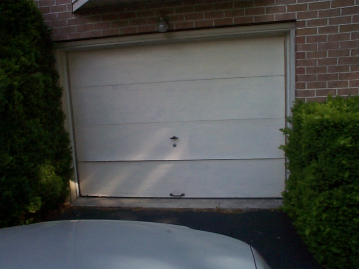 Charmant How To Repair Ripped And Peeling Surface Layer Of Wooden Garage Door Panel?