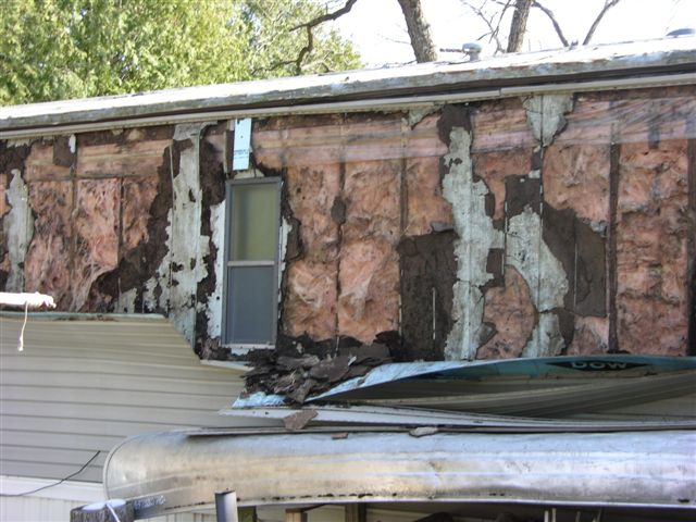 Vinyl siding over wood siding-wind-damage-024.jpg