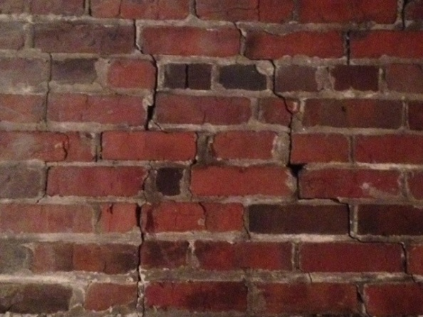 How serious is this cracking in brick interior wall?-windowdoorcrack2.jpg