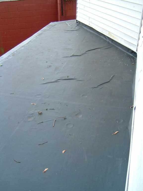 Good size wrinkles in new EPDM roof?-wrinkles-flat-roof-epdm.jpg