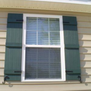 Board 'n' Batten shutters w/ hinges and S-hooks were my idea. Wife didn't want at first but now she is glad we did.