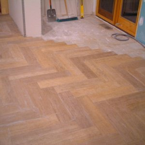 Faux wood planks that are actually porcelain tile. No grout lines.