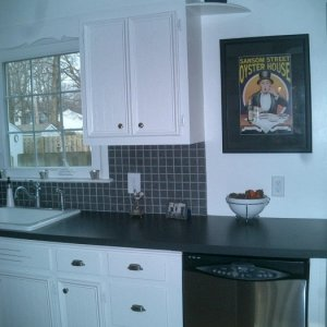 Better look at the backsplash and DW...