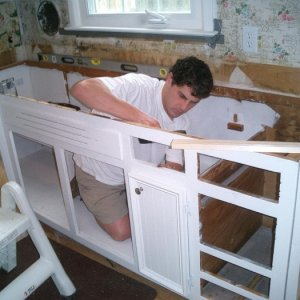 """leveling the base cabinets  for the counter-top install...  The change in the highest point to the lowest point was 1.25"""".  Lined the inside of the..."""