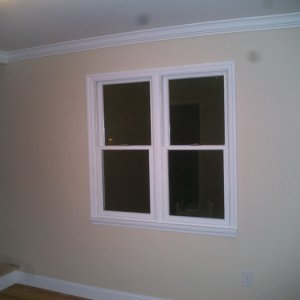 The front wall -- new windows are much more attractive then the old setup....