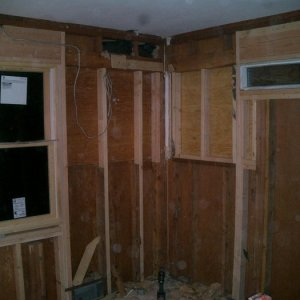 Rebuild -- new windows are in, and the old ones boarded up