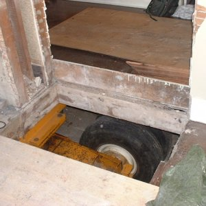 View of the wheels through opening where the chimney used to be.