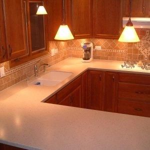 Tumbled limestone backsplash custom designed with all hand-honed cuts