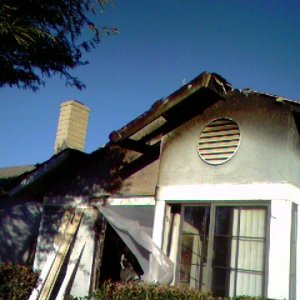 Front of the house after the fire. Firemen did most of the roof damage getting smoke & heat out. No one was home, dogs got out dog door. Our neighbor...