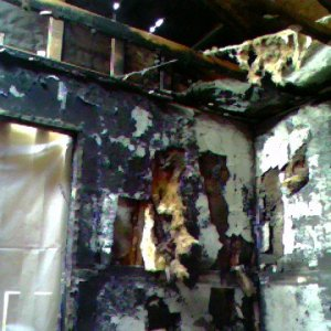 The bedroom where the fire started at a multiple wall outlet jack. The truss barely survived.