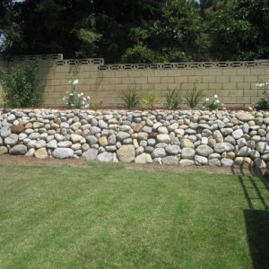 backyard free stacked rock wall - no mortar- Local river rock- This type of rock wall was used to control flood waters in the citrus groves that...