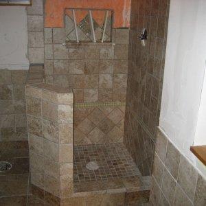 5) Shower in progress. Custom built niche
