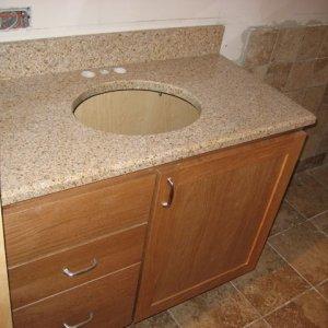 6) Oak vanity. Granite top