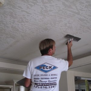 Skip Troweling this condo lobby in Cocoa Beach, Florida. This is after we removed the wallpaper from the ceiling.
