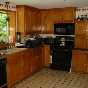 This kitchen was designed to mimic the Hoosier cabinet to the right of the stove which I built as a copy of an original I have. The kitchen window...
