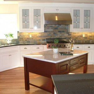 This kitchen was designed for a very busy mom who loved to bake cookies with her children. The cherry wood island has  Carrera Marble top. Counters...