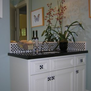 This bath was inspired by one of my favorite TV shows, Happy Days. I love anything black and white checkerboard.  The counter is black granite with...